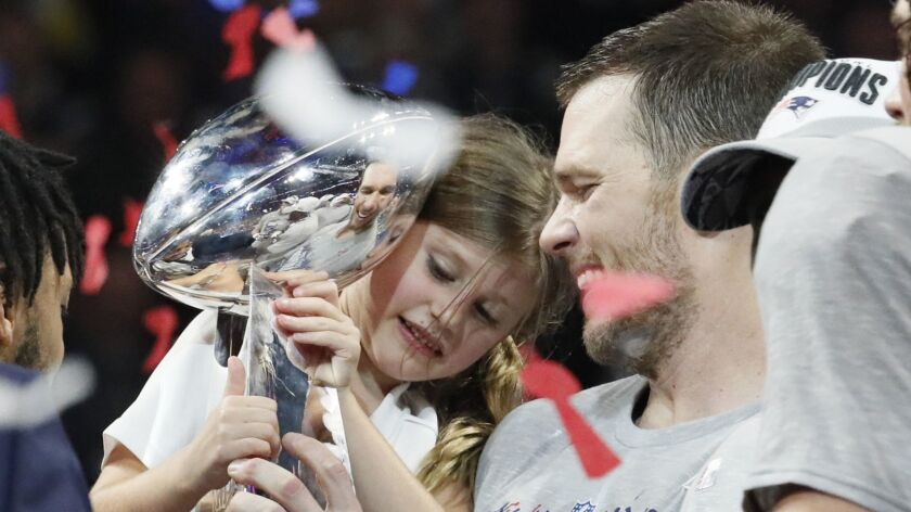 New England quarterback Tom Brady shares a moment with his 6-year-old daughter, Vivian Lake, after the Patriots won the Super Bowl 13-3 over the Los Angeles Rams on Sunday in Atlanta.