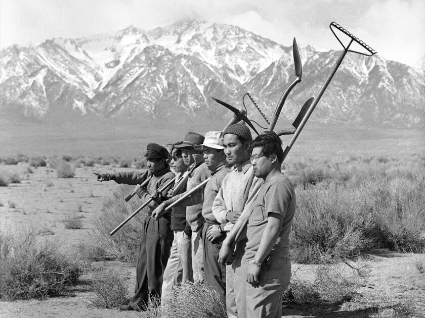 A group of Japanese men surveys the land in hope of starting a garden in a photo taken March 27, 1942. (AP Photo)