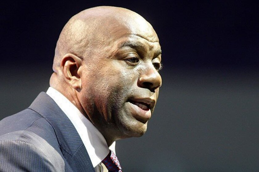 Lakers legend Magic Johnson considers the Miami Heat favorites to win NBA title.