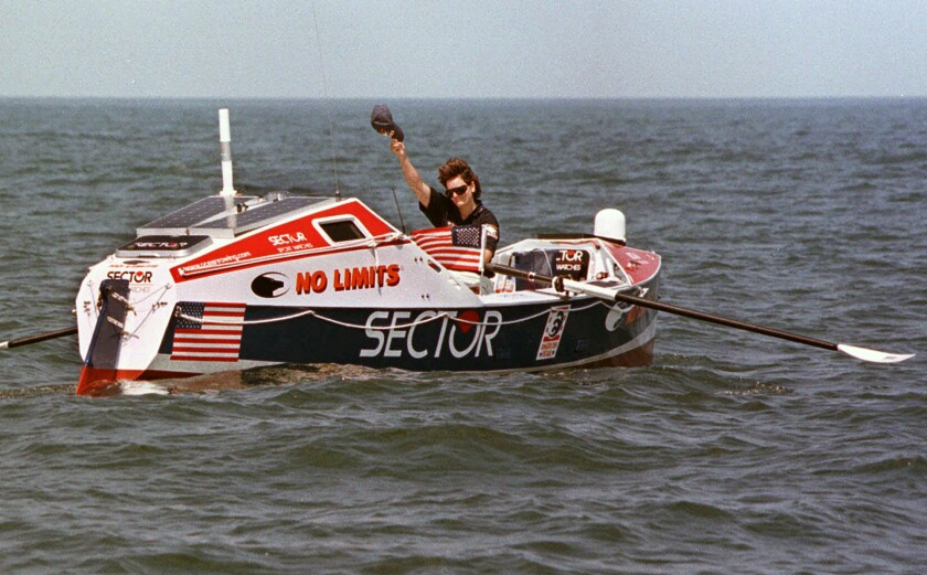 FILE - Rower Tori Murden, of Louisville, Ky., waves from her boat off North Carolina's Outer Banks, near Nags Head, N.C. , on June 14, 1998. A musical about Murden, who was the first American to row across the Atlantic Ocean solo in 1999, was supposed to make its stage debut at the Williamstown Theatre Festival in Massachusetts in the summer 2020. But due to the global pandemic, it is instead making its world premiere this month as a recording available on Audible. (AP Photo/Bob Jordan, File)