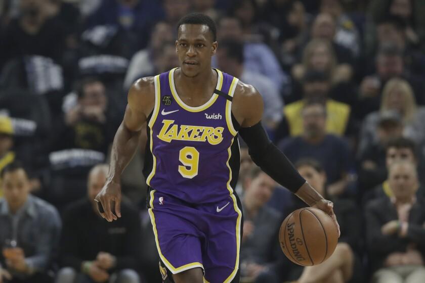 Lakers guard Rajon Rondo dribbles against the Warriors.