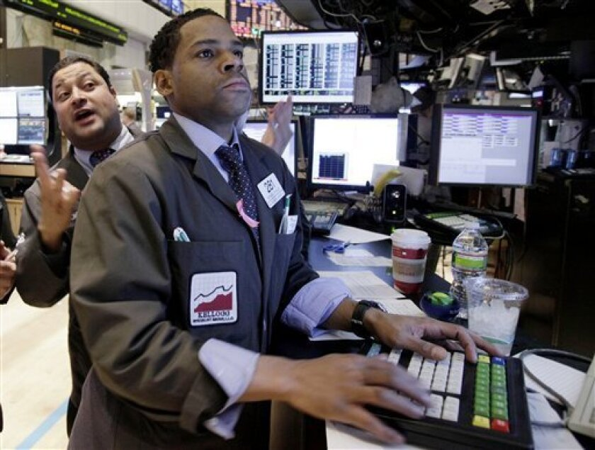 In this Nov. 3, 2010 photo, specialists Anthony Sherman, left, and Bernard Wheeler work on the floor of the New York Stock Exchange. (AP Photo/Richard Drew)