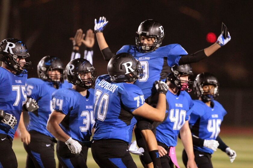 Ramona kicker Tyler Vargas is congratulated by teammates after connecting on a field goal for the Bulldogs, one of five undefeated teams in the San Diego Section.