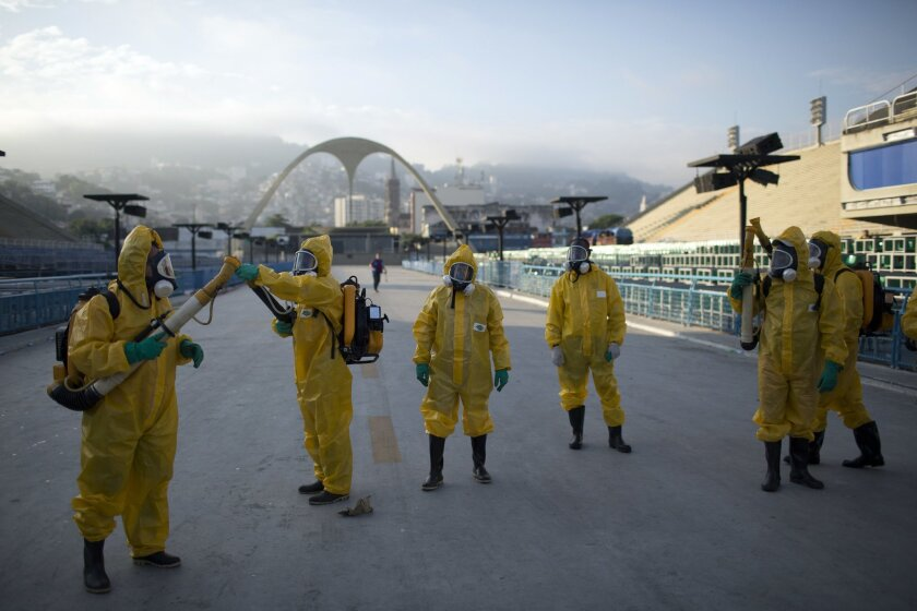 FILE - In this Tuesday, Jan. 26, 2016  file photo, health workers get ready to spray insecticide to combat the Aedes aegypti mosquitoes that transmits the Zika virus, under the bleachers of the Sambadrome in Rio de Janeiro, which will be used for the Archery competition in the 2016 summer games. Mo