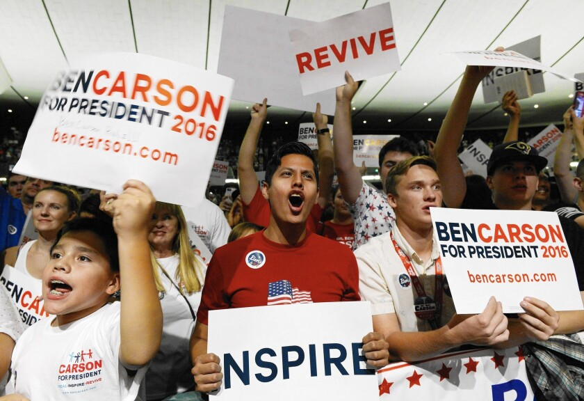 Supporters of GOP presidential candidate Ben Carson cheer during a campaign rally at the Anaheim Convention Center.