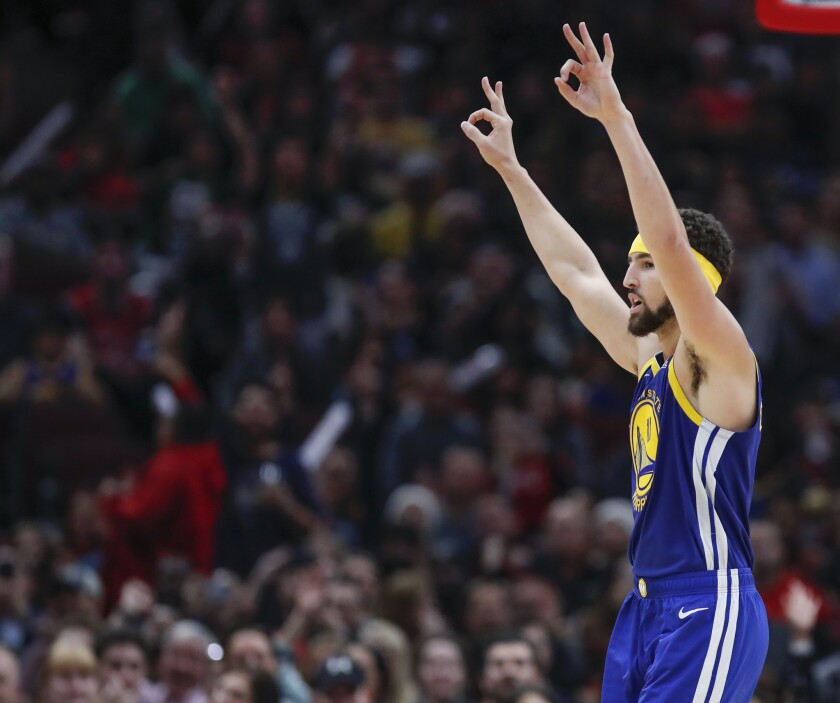 Golden State Warriors guard Klay Thompson celebrates after scoring a three pointer against the Chica