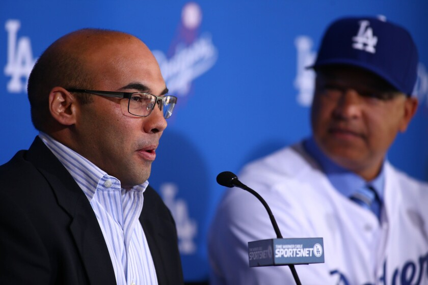Dodgers General Manager Farhan Zaidi speaks at a news conference introducing new Manager Dave Roberts, right, on Dec. 1.