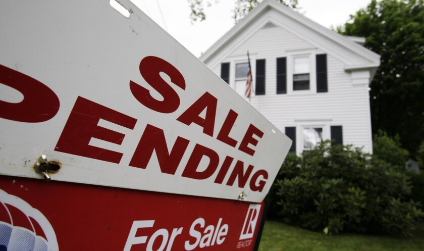 In the wake of losses tied to bad loans, the FHA has been raising its loan insurance fees and backing more loans to applicants with higher credit scores.