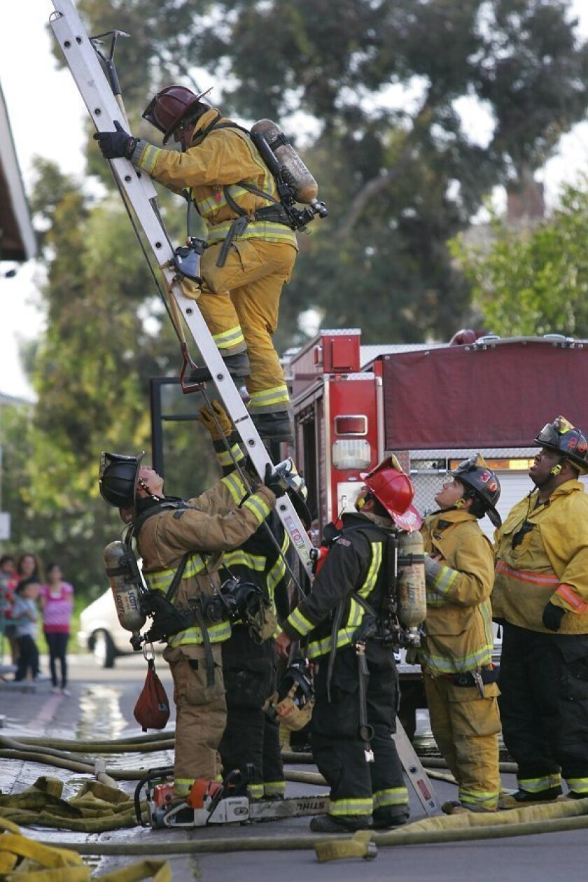Firefighters from San Diego and Chula Vista extinguish a blaze Thursday in an apartment complex in the 1000 block of West San Ysidro Boulevard.