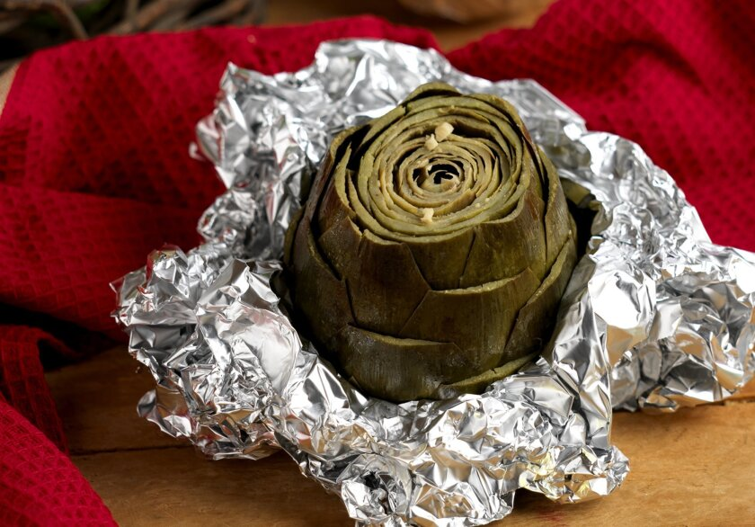 Baking an artichoke is an easy, and the results are flavorful.