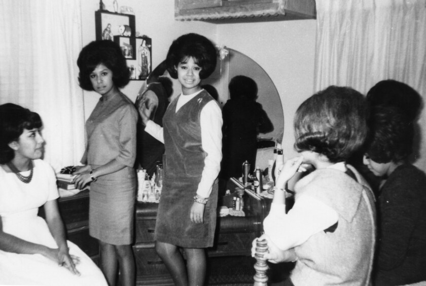 "A photograph of Marylou Martinez (far left), Mary Puga (center), and friends, getting ready to go to a party, 1964, featured in Carolyn Kozo Cole's project, ""Shades of L.A."""