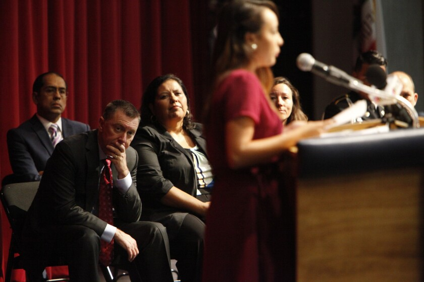 L.A. schools Supt. John Deasy, leaning forward, watches as Vanessa Perez, 18, recounts the hardships she overcame to graduate. He then assigned every administrator a troubled student to see through to graduation.