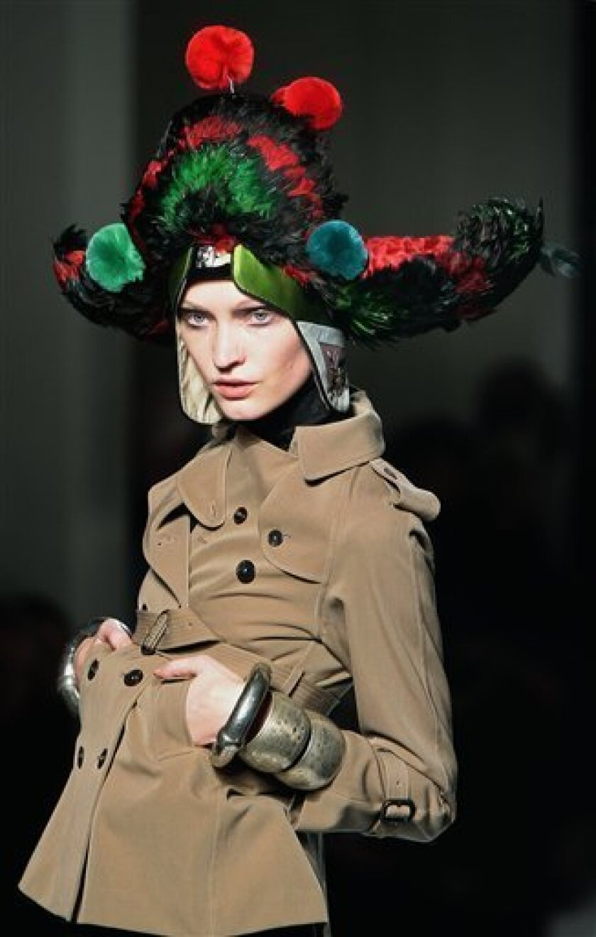 A model wears a creation by French fashion designer Jean Paul Gaultier as part of his Fall-Winter ready-to-wear fashion collection 2010, presented in Paris, Saturday March 6, 2010. (AP Photo/Jacques Brinon)
