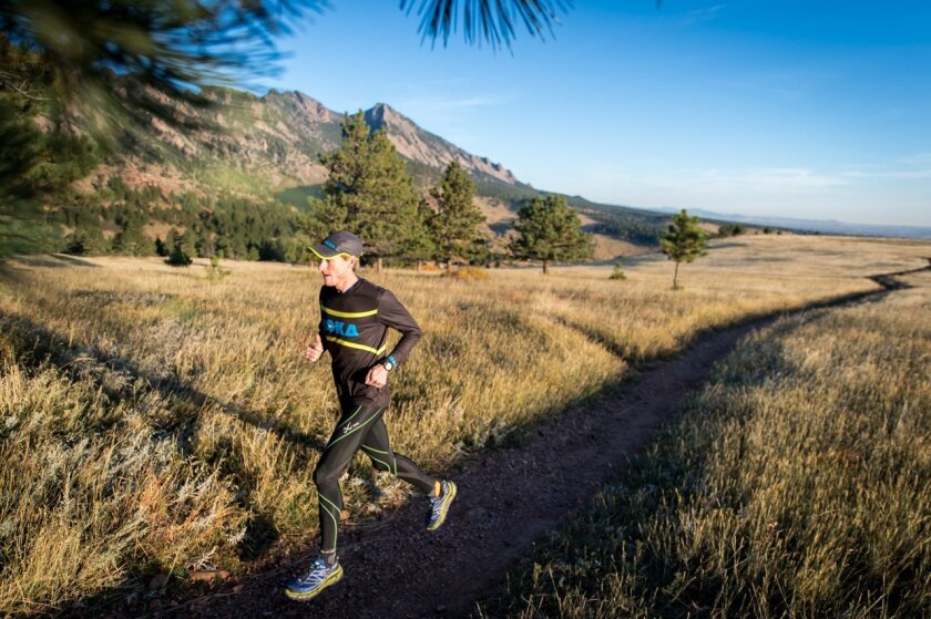 "In this October 2014, photo, Travis Macy trains near Boulder, Colo. Macy recently wrote the book, ""The Ultra Mindset: An Endurance Champion's 8 Core Principles for Success In Business, Sports and Life,"" and will run 31 miles from his home in Evergreen, Colo., to Denver on Friday, May 1, 2015, after"