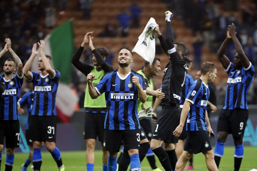 Inter Milan's Danilo D'Ambrosio, center, celebrates with his teammates their 1-0 victory at the end of a Serie A soccer match between Inter Milan and Lazio, at the San Siro stadium in Milan, Italy, Wednesday, Sept. 25, 2019. (AP Photo/Antonio Calanni)