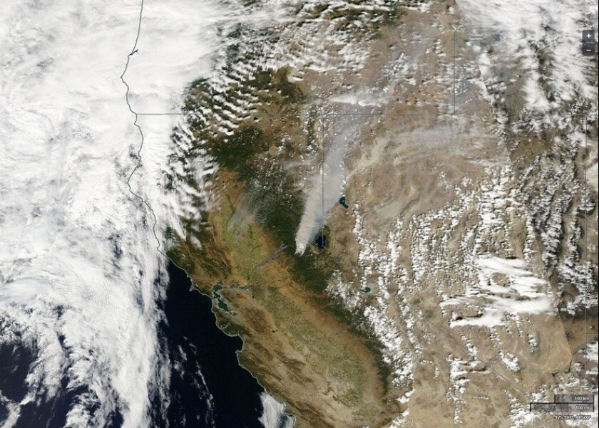 A satellite image released by the National Weather Service on Sept. 18 shows the large smoke plume of the King fire burning in the Eldorado National Forest.