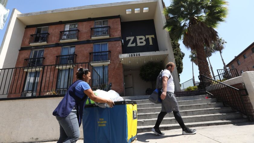 LOS ANGELES, CA - AUGUST 31, 2018 - People walk past the Zeta Beta Tau fraternity house at 10924 Str