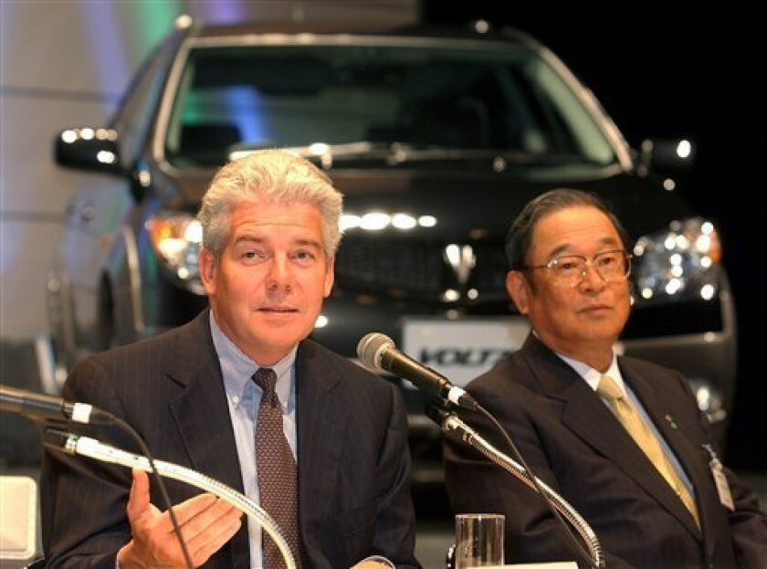 """FILE - In this Aug. 20, 2002 file photo, General Motors Group Vice President Mark T. Hogan, left, speaks as Toyota Motor Corp. President Fujio Cho looks on during a press unveiling of compact sport utility vehicle """"Voltz,"""" jointly designed by Toyota and General Motors Corp. in Tokyo. Toyota has tapped a former executive at U.S. rival General Motors to be on its board, the first time in the Japanese automaker's 76-year history it is appointing board members from outside the company. The appointme"""