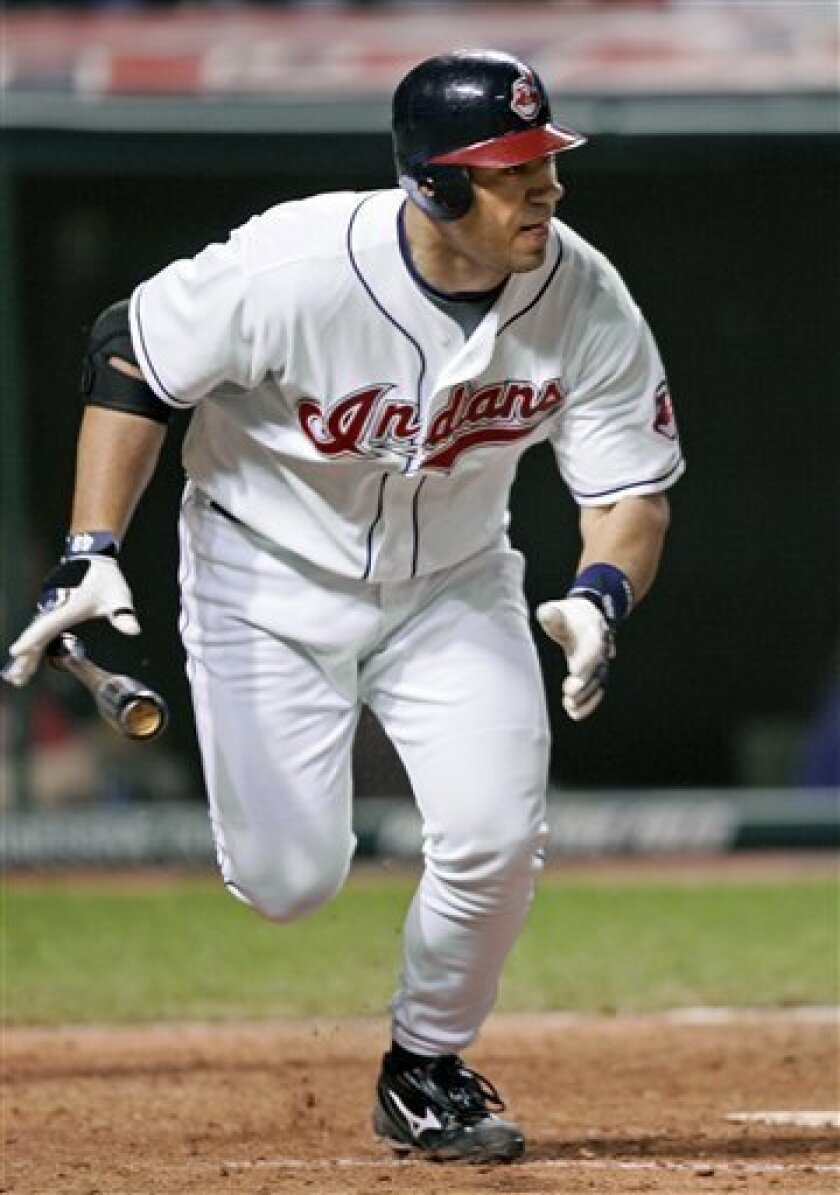 Cleveland Indians designated hitter Travis Hafner watches his two-run home run off Detroit Tigers relief pitcher Zach Miner in the sixth inning of a baseball game Thursday, April 17, 2008, in Cleveland. (AP Photo/Mark Duncan)