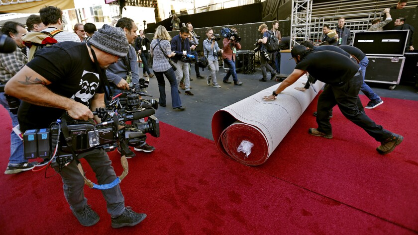 A cameraman films the red carpet rollout.