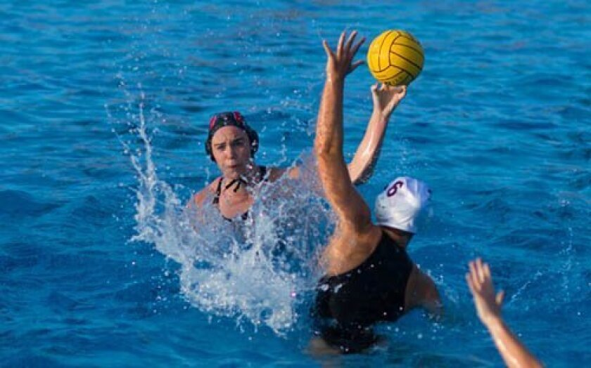 La Jolla High's lefty Scarlett Hallahan lofts a shot toward the left end of the goal over Bishop's defender Jill Bushman in the third quarter. The shot went wide left.