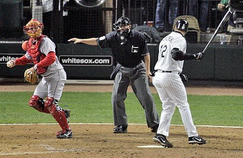 Umpire Doug Eddings puts his hand out, signaling that A.J. Pierzynski swung at the pitch from Kelvim Escobar.