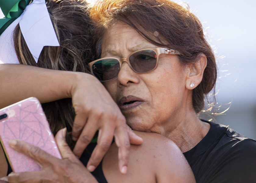 Costa Mesa's Diane Molina gets a hug from her grandmother Lupe Molina after finishing first in the O