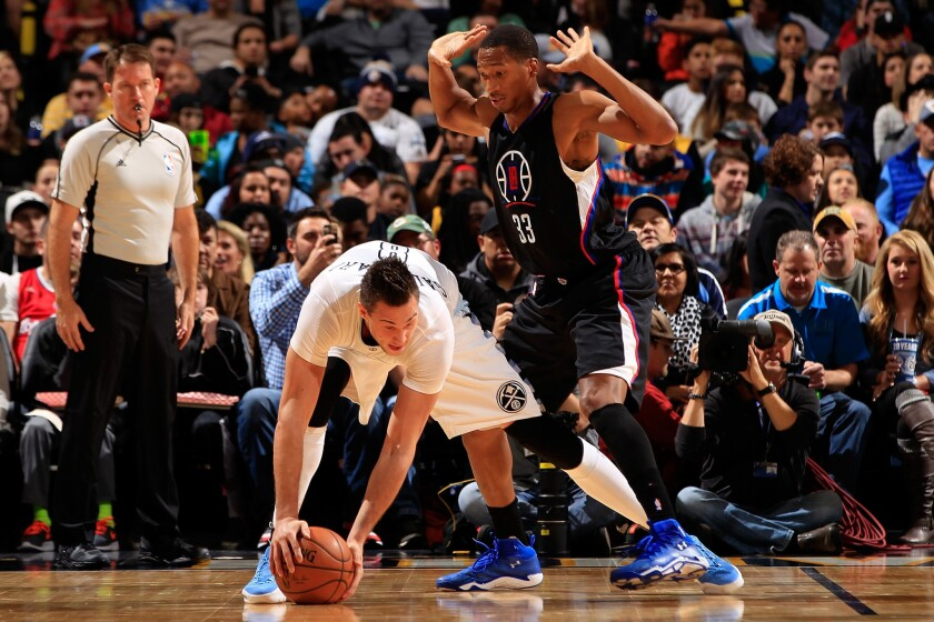 Clippers guard Wesley Johnson guards Nuggets forward Danilo Gallinari during a game in Denver on Nov. 24.