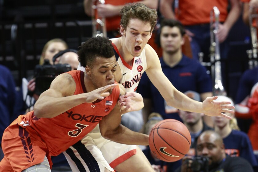 Virginia Tech guard Wabissa Bede (3) steals the ball from Virginia guard Kody Stattmann (23) during the first half of an NCAA college basketball game in Charlottesville, Va., Saturday, Jan. 4, 2020. (AP Photo/Steve Helber)