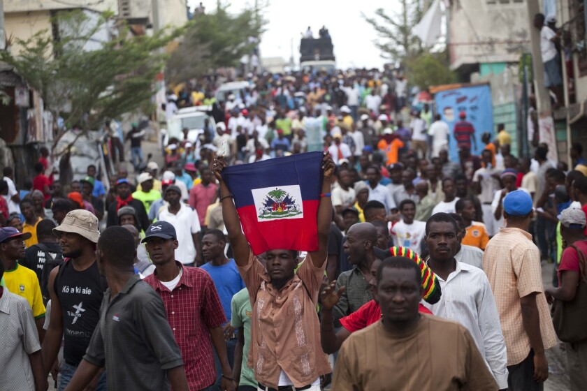 Demonstrators protest the government of President Michel Martelly in Port-au-Prince, Haiti, on Sunday.