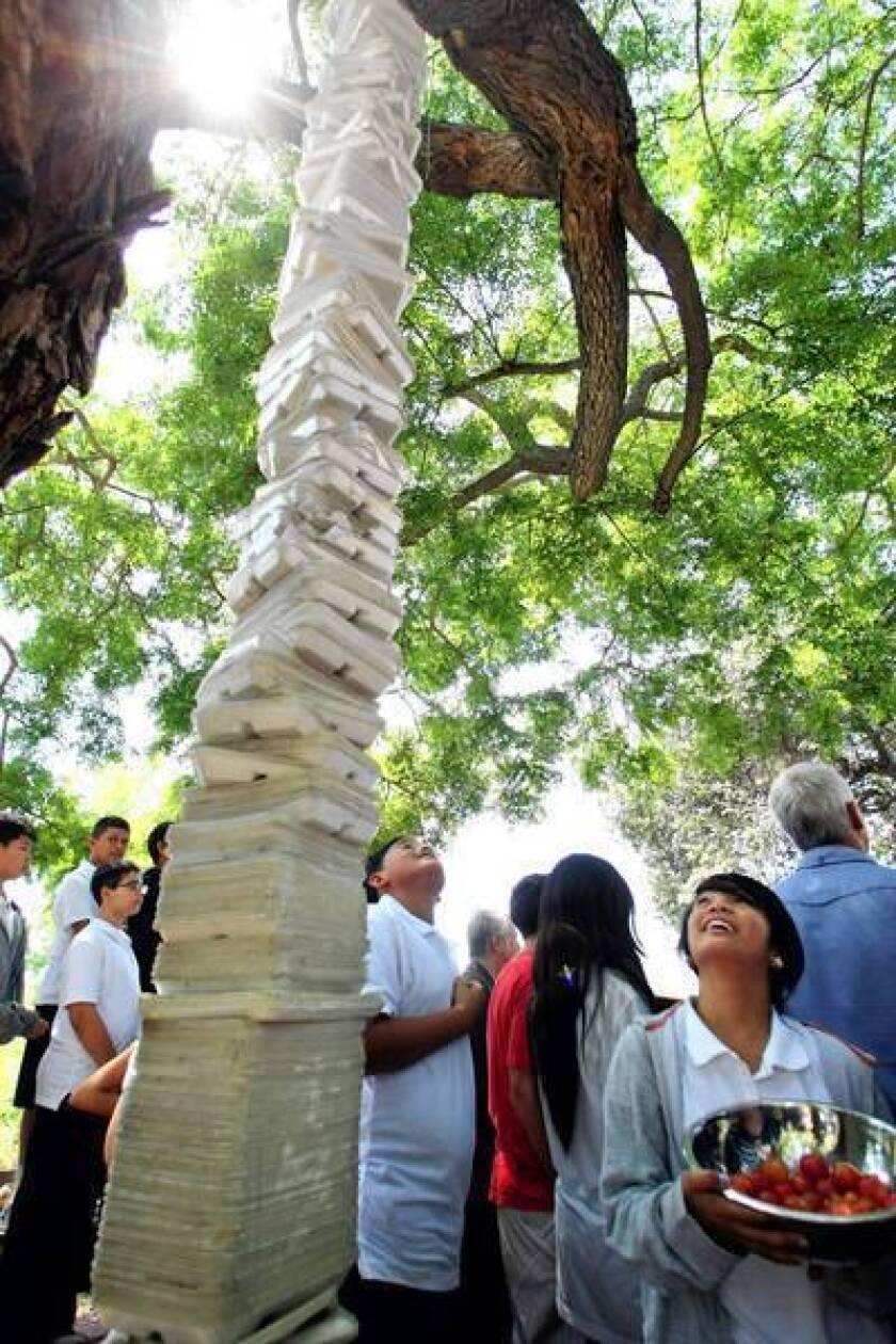 Students at Thomas Starr King Middle School in Los Feliz look up at a sculpture they made of 1,260 plastic foam cafeteria trays. The nonbiodegradable trays are being replaced with paper ones.