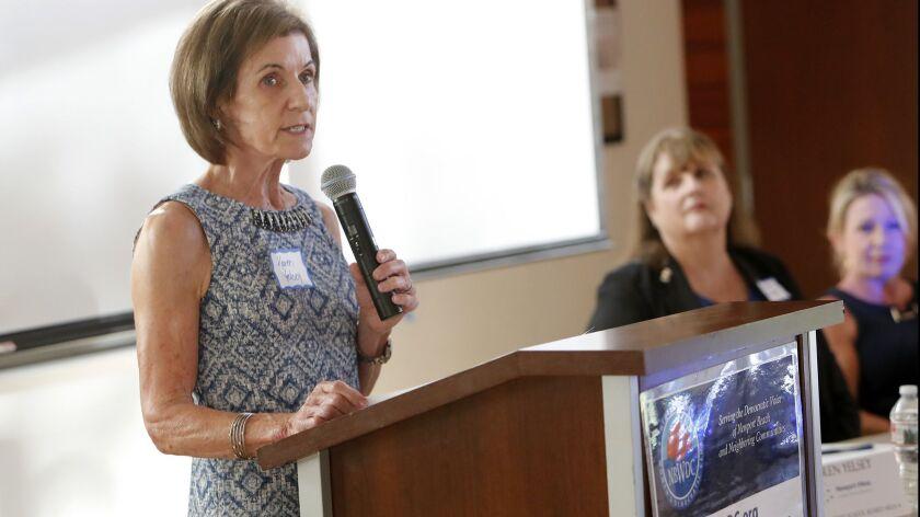 Karen Yelsey, trustee area 4 candidate, speaks during a Newport-Mesa Unified School District board c