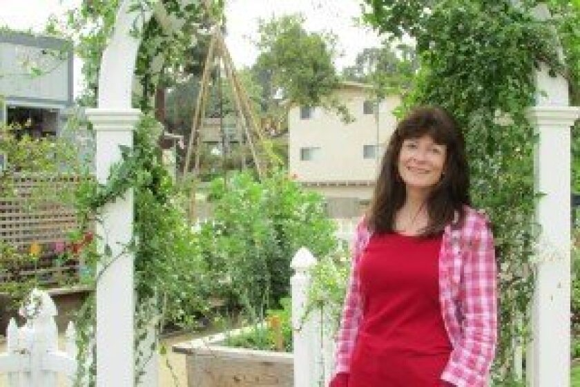 Andi MacLeod in the garden at the Boys & Girls Clubs of San Dieguito's La Colonia Branch. Photo/Kristina Houck