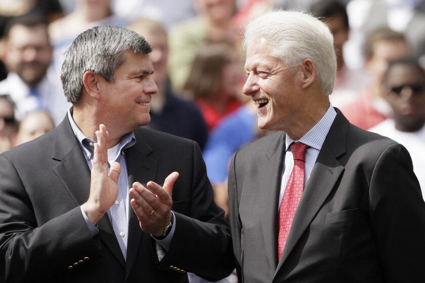 Democratic candidate for Arkansas governor Mike Ross, left, applauds former President Bill Clinton during a political rally at the University of Central Arkansas in Conway, Ark., Monday, Oct. 6, 2014. Clinton is headlining a series of rallies around the state this week to support Arkansas Democrats. (AP Photo/Danny Johnston)