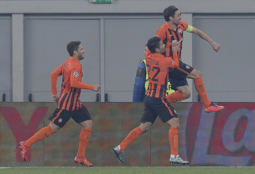 Shakhtar's Darijo Srna, right, jumps in the air after scoring his side's 2nd goal as he celebrates with teammates during the Champions League Group A soccer match between FC Shakhtar and Malmo at Arena Lviv stadium in Lviv, western Ukraine, Tuesday, Nov. 3, 2015. (AP Photo/Efrem Lukatsky)