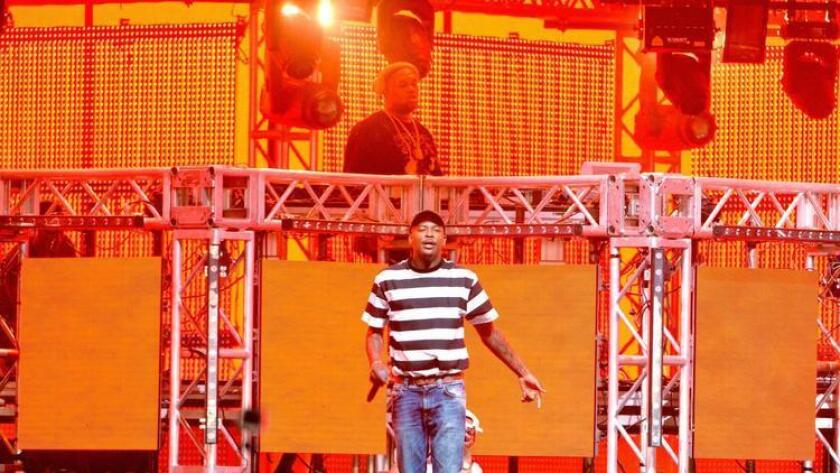 DJ Mustard (back) and hip-hop artist YG perform onstage during day 1 of the 2016 Coachella Valley Music & Arts Festival Weekend 1 at the Empire Polo Club on April 15, 2016 in Indio. (Michael Tullberg)