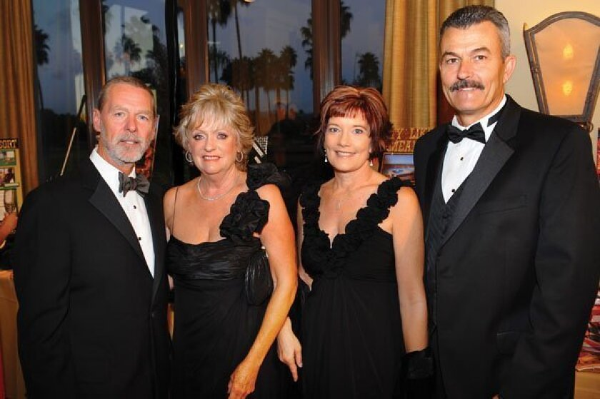 Duffy and Judy Keys (Live and Super Silent Auction Chair), Lori and Barry Jung. Photos by Jon Clark