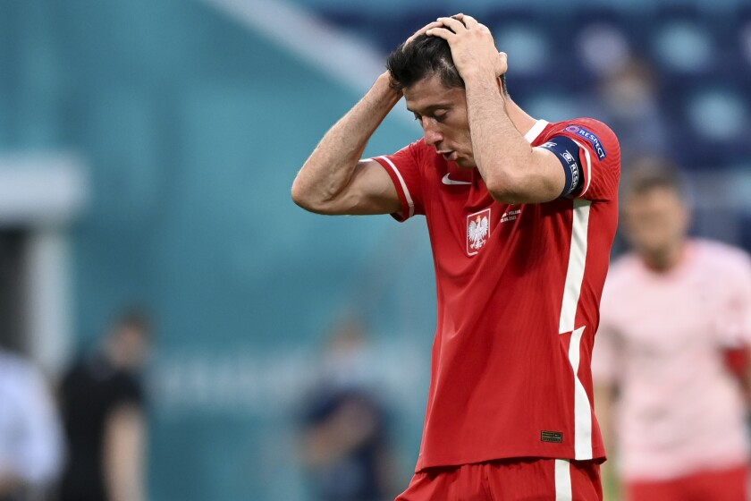 Poland's Robert Lewandowski reacts at the end of the Euro 2020 soccer championship group D match between Sweden and Poland, at the St. Petersburg stadium in St. Petersburg, Russia, Wednesday, June 23, 2021. Sweden won 3-2. (AP Photo/Kirill Kudryavtsev, Pool)