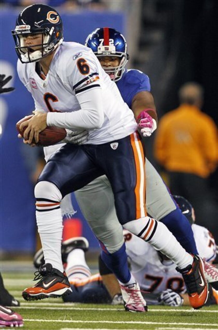 Chicago Bears quarterback Jay Cutler (6) is sacked by New York Giants defensive end Osi Umenyiora during the first quarter of an NFL football game at New Meadowlands Stadium on Sunday, Oct. 3, 2010, in East Rutherford, N.J. (AP Photo/Kathy Willens)