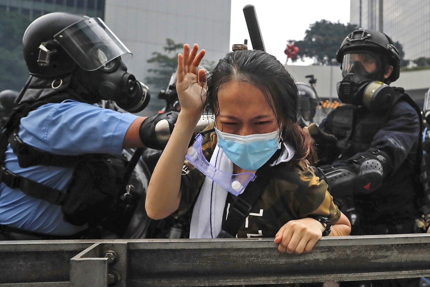 Riot police confront a protester during a massive demonstration in Hong Kong on June 12.