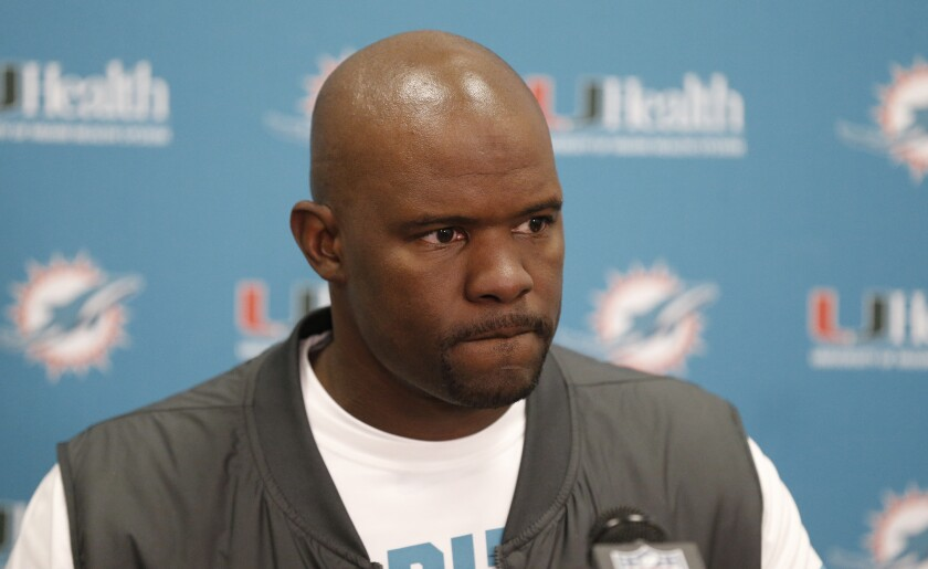 FILE - This is a Nov. 24, 2019, file photo showing Miami Dolphins head coach Brian Flores answering questions after an NFL football game against the Cleveland Browns, in Cleveland. Dolphins coach Brian Flores is mourning the death of Chris Beaty, a good friend and former Indiana University football player who was fatally shot after violence erupted during an Indianapolis protest.(AP Photo/Ron Schwane)