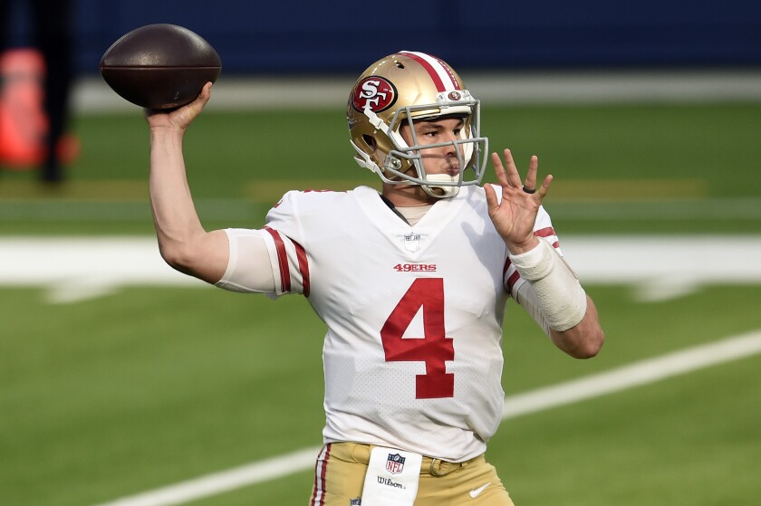 San Francisco 49ers quarterback Nick Mullens throws against the Los Angeles Rams during the first half of an NFL football game Sunday, Nov. 29, 2020, in Inglewood, Calif. (AP Photo/Kelvin Kuo)