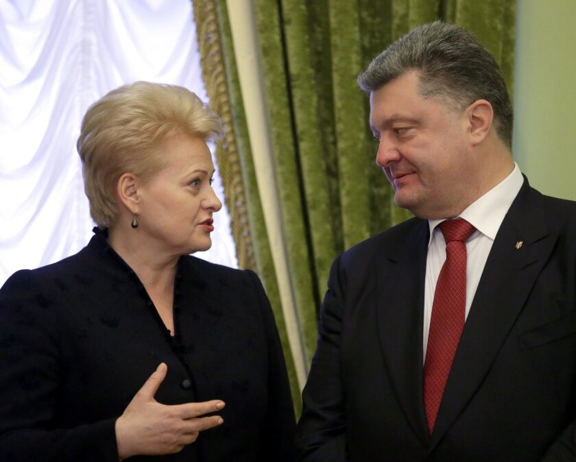 Ukrainian President Petro Poroshenko, right, with President Dalia Grybauskaite of NATO-member Lithuania at a Kiev news conference where he said that whether Ukraine joins the Western military alliance will be decided by voters years from now.