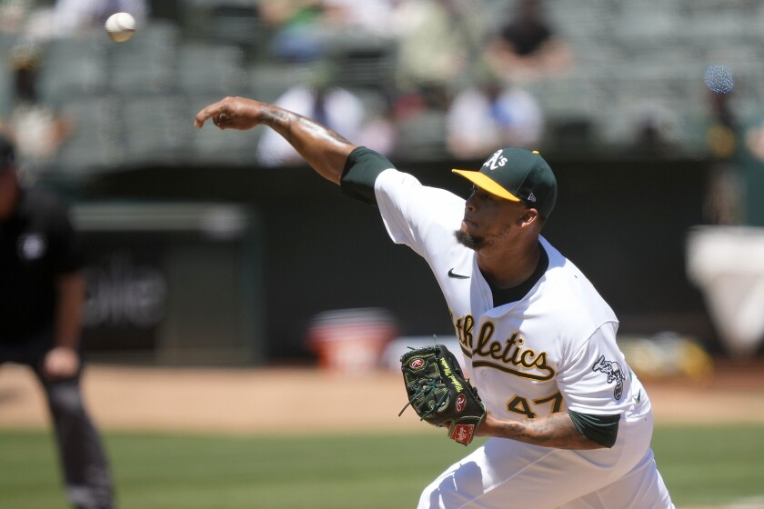 Oakland Athletics starting pitcher Frankie Montas throws against the Tampa Bay Rays during the first inning of a baseball game Saturday, May 8, 2021, in Oakland, Calif. (AP Photo/Tony Avelar)