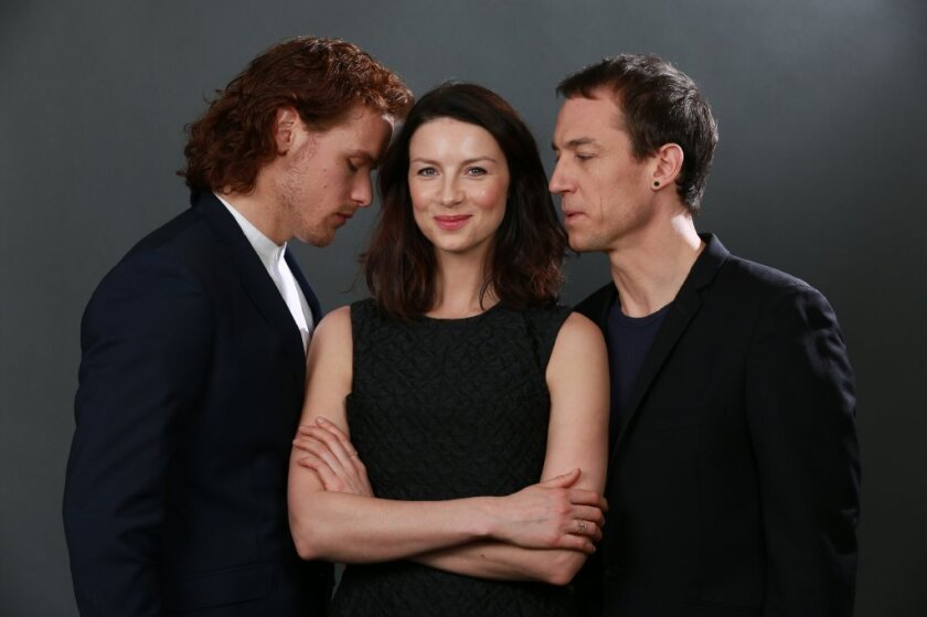 "The cast of ""Outlander"": Sam Heughan, Caitriona Balfe and Tobias Menzies"