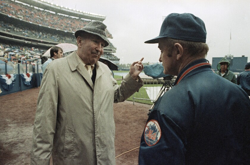 Chub Feeney, then National League president, talks with Mets groundskeeper Pete Flynn before 1986 playoff game in New York.