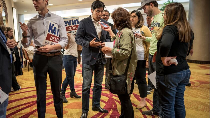 Jun 14, 2018 OAKLAND, CA. Kevin de Leon speaks center speaks to reporters during Democratic state ca