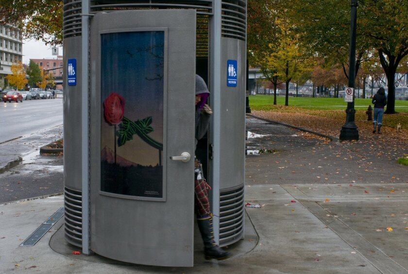 This Nov. 9, 2010 photo shows a Portland Loo in downtown Portland, Ore. The Oregonian reports the city has now agreed to allow the toilet's manufacturer to set the price and market the toilets, giving the city a royalty. (AP Photo/The Oregonian, Beth Nakamura)  MAGS OUT; TV OUT; LOCAL TELEVISION OU