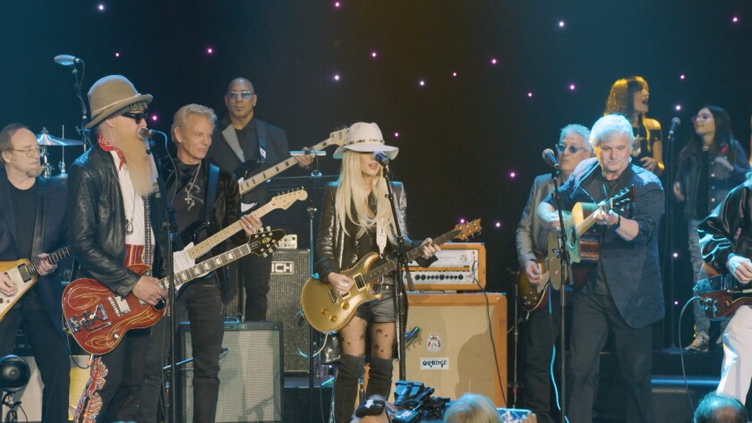The 2018 edition of the America Salutes You Guitar Legends concert at L.A. Live included, from left, Stephen Stills, Billy Gibbons, Don Felder, Carmine Rojas, Orianthi, Phil LoPresti and, playing acoustic guitar, Laurence Juber.