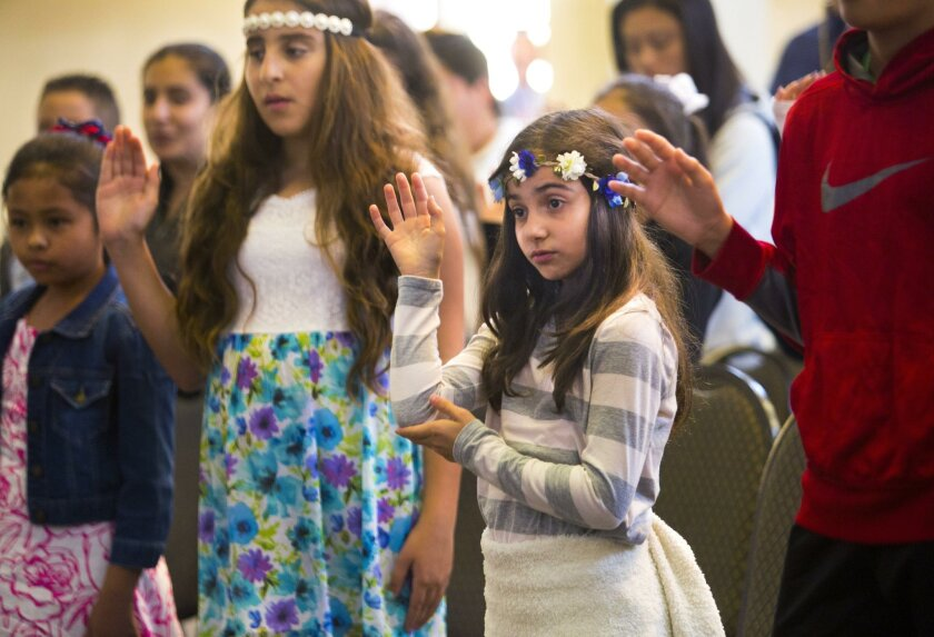 Children honored in citizenship ceremony at San Diego's New